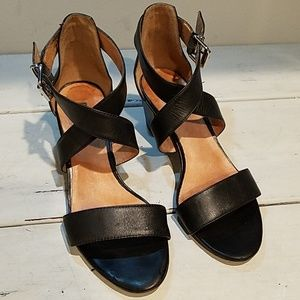 Black leather strap around the ankle heel
